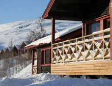 Your luxury chalet with access to ski slopes by day and appearances of the Northern Lights by night.