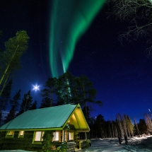 Northern Lights over Log Cabins